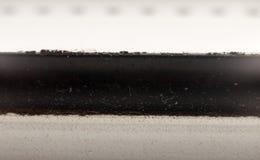 Close up texture macro background of black strip through white b. Ackground; UK Stock Image