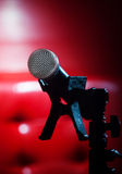 Close up texture of microphone in music hall against red luxury Royalty Free Stock Images