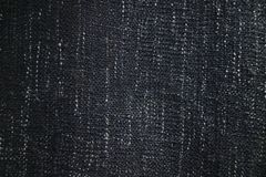 Close up texture of navy blue fabric blanket or throw. Black,grey and white vertical flecks. In thread of woven material. Useful as texture map or background royalty free stock photos