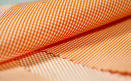 Close up texture orange and white scott pattern fabric of shirt Stock Photos