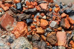 Close-up texture. Red stone and gravel sand water. Close-up texture Red stone and gravel sand water stock photography
