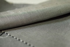 Close up texture stripe gray and black fabric of shirt Stock Image