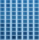 Close-up texture view of a blue skyscraper with many windows Stock Image