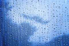 Close up texture of water drop background on blue mirror use as Stock Photo