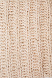 Close up texture of woolen beige scarf Stock Images