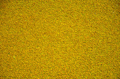 Close up Texture of yellow rubber floor on playground Stock Image