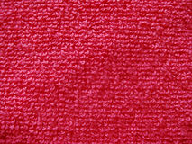 Close-up of textured fabric, cozy towel textile in bright pink stock photography