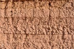 Textured wall of Mud brick house in Sudan. stock photo