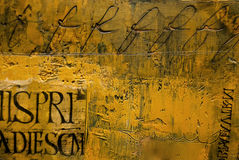 Close-up of textured wax painting with lettering. Section of photographer's own encaustic wax painting, showing Latin script and calligraphy Royalty Free Stock Photo