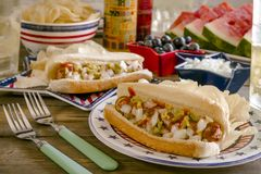 Summer holiday picnic with hot dogs and chips stock image