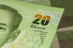 Close up of Thai banknote Thai bath with the image of Thai King. Thai banknote of 20 Thai baht on Green Scottish fabric. Stock Photography