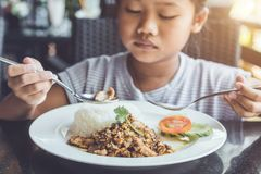 Thai children eating in restaurant. Bored with food concept. Close up Thai children eating in restaurant. Bored with food concept royalty free stock photography