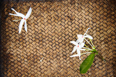 Close up Thai flower on bamboo mat Royalty Free Stock Images