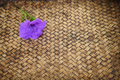 Close up Thai flower on bamboo mat Stock Images