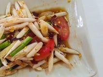 Close-up,Thai food stlye:The lotus stem salad. Royalty Free Stock Photo