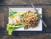 Close up thai noodle or pad thai on wood Royalty Free Stock Photo