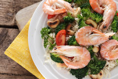 Close up of thai rice with shrimp and cashew. On the wooden background royalty free stock photography