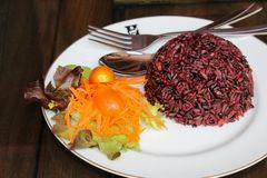 Steamed riceberry rice on a plate