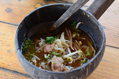 Thai spicy noodle in coconut shell Stock Images