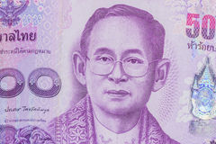Close up of thailand currency, thai baht with the images of Thailand King. Denomination of 500 bahts. Royalty Free Stock Photo