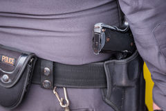 Close up of Thailand's police pistol, Policeman's equipment belt. Close up of Thailand& x27;s police pistol, Policeman& x27;s equipment belt holding his weapon Royalty Free Stock Image