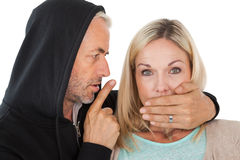 Close up of theft covering womans mouth Stock Photos