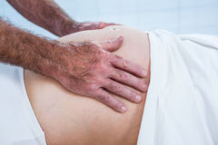 Close-up of therapist massaging belly of pregnant woman Stock Images