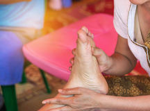 Close up of therapist`s hands massaging female foot Royalty Free Stock Images