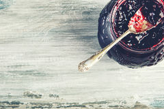 Close up of thick sweet strawberry jam with old spoon. Royalty Free Stock Photography
