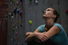 Close up of thoughtful athlete looking up in health club. Close up of thoughtful athlete looking up while relaxing in health club royalty free stock photo