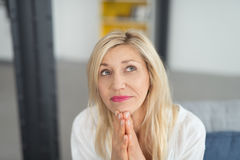 Close up Thoughtful Blond Adult Lady Looking Up Royalty Free Stock Image