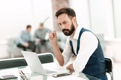 Close up.thoughtful businessman sitting at an office Desk royalty free stock photo