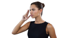 Close up of thoughtful businesswoman gesturing while looking away Royalty Free Stock Photo