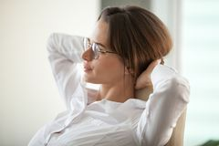 Close up of thoughtful businesswoman leaning in chair resting stock photo