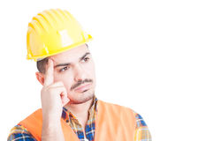 Close-up of thoughtful constructor with helmet and protection eq Stock Images