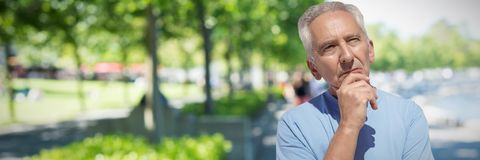 Composite image of close up of thoughtful senior man with hand on chin. Close up of thoughtful senior man with hand on chin against blur view of park Royalty Free Stock Photos