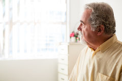 Close up of thoughtful senior man relaxing at nursing home Stock Photography
