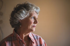 Close up of thoughtful senior woman at home Stock Photo