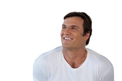 Close-up of thoughtful smiling mature man looking away. Against white background Royalty Free Stock Photo