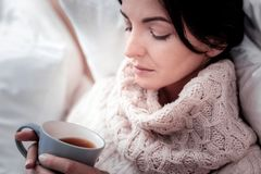 Close up of thoughtful woman with a cup of tea royalty free stock photography
