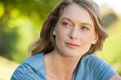 Close-up of thoughtful woman looking away in park Stock Image