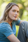 Close-up of thoughtful woman looking up in park Stock Photo