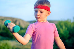 Close up Thoughtful Young Boy Lifting Dumbbell Stock Images
