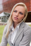 Close-up of thoughtful young businesswoman looking away against office building Royalty Free Stock Photography