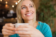 Close-up of thoughtful young woman holding coffee cup Stock Photography