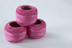 Pink crochet yarn against white background, space for text stock photos