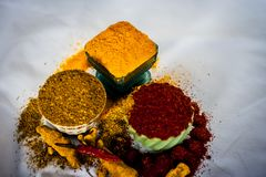 Basic spices of Indian food. Close up of three basic spices of Indian Asian food that are red pepper powder, turmeric powder and Dried coriander seed powder  on Royalty Free Stock Photos