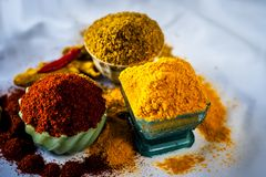 Basic spices of Indian food. Close up of three basic spices of Indian Asian food that are red pepper powder, turmeric powder and Dried coriander seed powder  on Royalty Free Stock Images