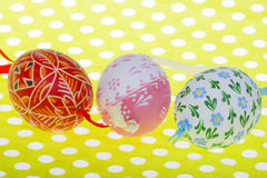 Close-up of three Easter eggs on green background royalty free stock images