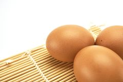 Three eggs on bamboo mat. Close up three eggs on bamboo mat Stock Image